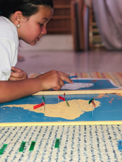 Elementary Student Working in Montessori Classroom